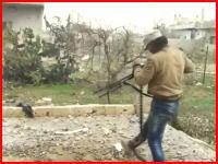 シリア動画。機関銃を構えた戦闘員がカメラの目の前でヘッドショットされてしまうビデオ。